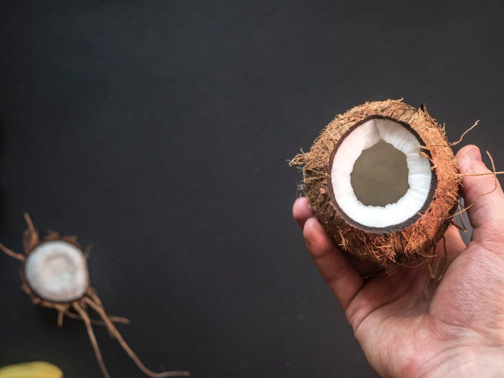 man holding a coconut