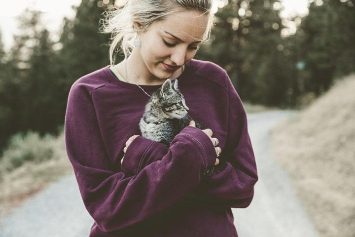 lady hugging her cat