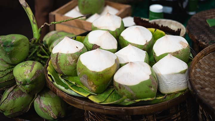 Fresh coconuts in the Asian market