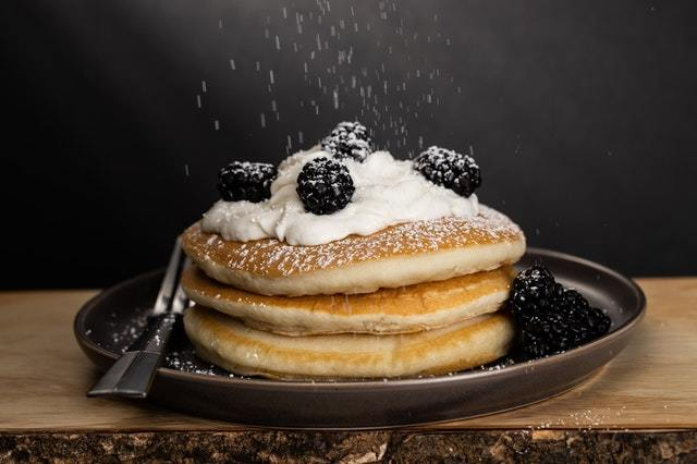 Berry and Coconut cream topping pancakes