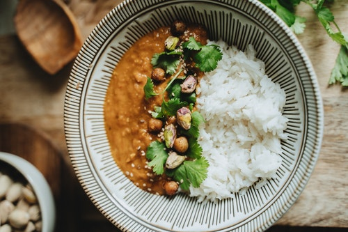 Rice and Gravy Garnished With Coriander