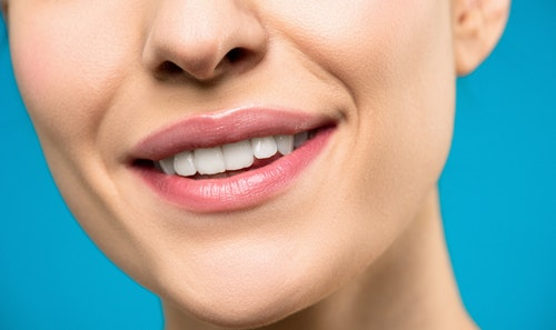 Closer look of a smiling woman with pink lips