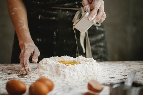 Lady making dough for pastries