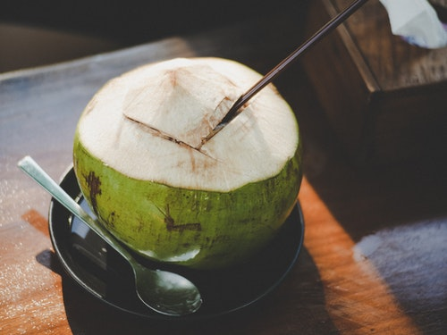 Green King Coconut On A Black Tray