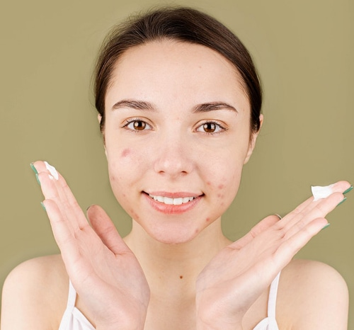 Woman with face cream on her hands