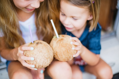 Children with coconuts