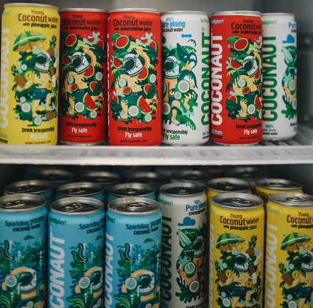 Colorful cans stored in freezer