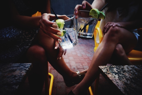 two women chilling with drinks