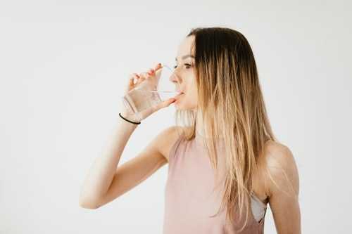 Young lady consuming pure water